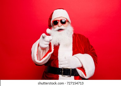 Holly jolly x mas noel! December, winter, surprise, travel, trips, party time! Cool cheerful aged modern playful naughty tourist santa grandfather in eyewear, fooling around, hold his big belly