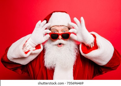 Holly jolly x mas noel! Increadible unbelievable crazy december surprise travel trips time omg! Closeup of aged excited astonished tourist santa with wide open eyes, mouth, adjusting eye wear