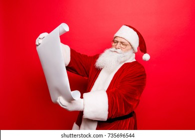 Holly jolly x mas, noel is soon! Concentrated pensive santa think, study list of children's wishes and gifts, on white paper whatman, smiling and ready to make dreams come true, happiness to kids