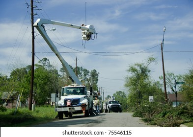 HOLLY SPRINGS, NC, USA - APRIL 18: After a tornado men from energy companies are trying to restore the power in the town of Holly Springs on April 18, 2010 in Holly Springs, NC, USA