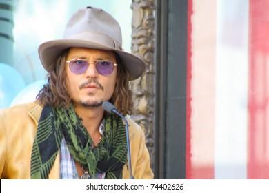 HOLLYWOOD - APRIL 1: Actor Johnny Depp at the Walk of Fame ceremony for Penelope Cruz April 1, 2011 Hollywood, CA.