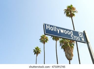 Hollywood Boulevard sign with palm trees in the background