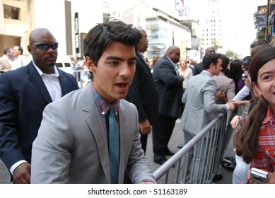 """HOLLYWOOD, CA- APRIL 17: Singer Joe Jonas arrives at the premiere of the movie """"Oceans"""" at the El Capitan theatre, April 17, 2010 in Hollywood, CA."""