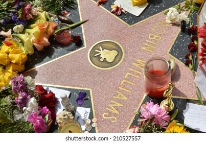 HOLLYWOOD, CA - AUGUST 12, 2014: Robin Williams' star on the Hollywood Walk of Fame is surrounded by flowers and various memorial tributes left by fans on August 12, 2014