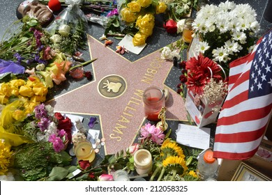 HOLLYWOOD, CA - AUGUST 12, 2014: Robin Williams' star on the Hollywood Walk of Fame is surrounded by flowers and various memorial tributes left by fans on August 12, 2014 in Hollywood, California.