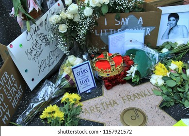 "HOLLYWOOD CA - AUGUST 16, 2018: Fans leave flowers and feelings at the star of ""The Queen of Soul"" Aretha Franklin on the Hollywood Walk of Fame after learning of her passing August 16, 2018."