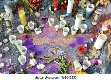 HOLLYWOOD, CA - JANUARY 11, 2016: David Bowie's star on the Hollywood Walk of Fame is surrounded by flowers and various memorial tributes left by fans on January 11, 2016.