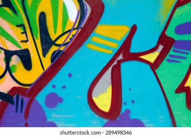 HOLLYWOOD, CA - JUNE, 20 2015: Colorful graffiti lettering on the side of an old weathered building. Most consider graffiti to be vandalism and destruction of private property.