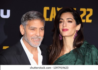 HOLLYWOOD, CA - MAY 07, 2019: George Clooney and wife Amal at the premiere of CATCH-22 on May 7, 2019 at the TCL Chinese Theatre in Hollywood, CA.