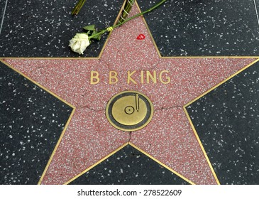 HOLLYWOOD, CA -MAY 16, 2015: A flower left by a fan rests on B.B.King's star on the Hollywood Walk of Fame on May 16, 2015 in Hollywood, California.
