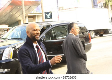 "HOLLYWOOD, CA - NOVEMBER 13, 2011:  Rapper Common is going over to fans sign their posters outside Grauman's Chinese Theatre at premiere of the movie ""Happy Feet"" on November 13, 2011 Hollywood, CA."