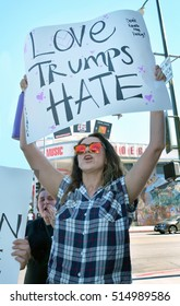 HOLLYWOOD, CA - NOVEMBER 13 2016: A protester shouts and holds a sign above her head which reads, Love Trumps Hate during an anti Trump rally on November 13, 2016 in Hollywood, California.