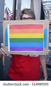 HOLLYWOOD, CA - NOVEMBER 13 2016: A protester holds a sign featuring rainbow colored stripes during an anti Donald Trump rally on November 13, 2016 in Hollywood, California.