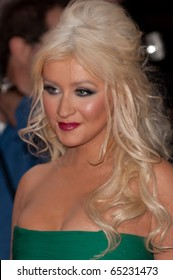 HOLLYWOOD, CA - NOVEMBER 15: Actress and singer Christina Aguilera arrives to the premiere of the movie Burlesque at the Grauman's Chinese Theater, on November 15, 2010 in Los Angeles, CA