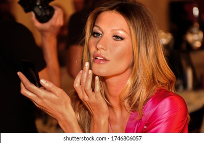 HOLLYWOOD, CA - NOVEMBER 16: Gisele Bundchen getting ready for Victoria's Secret 2006 Fashion Show - Backstage at Kodak Theater on November 16, 2006 in Hollywood, CA