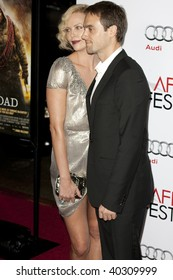 HOLLYWOOD, CA. - NOVEMBER 4: Charlize Theron (L) and Stuart Townsend (R) attend the AFI Fest screening of The Road on November 4, 2009 at The  Grauman's Chinese Theater in Hollywood.