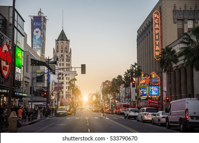 HOLLYWOOD, CA - OCTOBER 12, 2016: View of Hollywood Boulevard at sunset. In 1958, the Hollywood Walk of Fame was created on this street as a tribute to artists working in the entertainment industry.