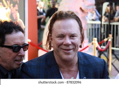 HOLLYWOOD, CA, OCTOBER 31: Actor Mickey Rourke and friends after actor's imprint ceremony in front of the Chinese Theatre in Hollywood, California, on October 31, 2011.