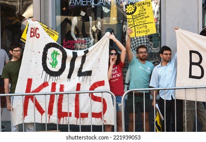 HOLLYWOOD, CA - SEPTEMBER 18, 2014: Shouting protestors hold a large banner and sign protesting the use of fracking to drill oil during a demonstration in Hollywood, California on September 18, 2014.