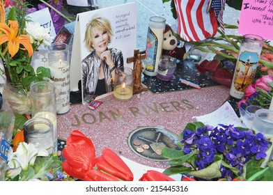 HOLLYWOOD, CA SEPTEMBER 6, 2014: Joan Rivers' star on the Hollywood Walk of Fame is surrounded by flowers and various memorial tributes left by fans on September 6, 2014.