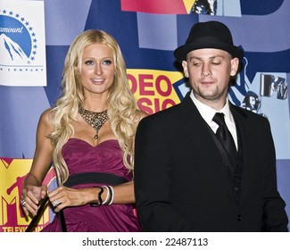 HOLLYWOOD, CA - SEPTEMBER 7:  Socialite Paris Hilton and Musician Benji Madden pose together in the press room at the 2008 MTV Video Music Awards at Paramount Pictures Studio in Hollywood, California.