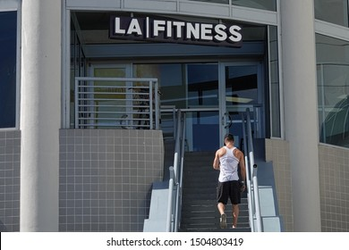 Hollywood, CA / USA - Aug. 18, 2019: An LA Fitness location is shown during the day, with a gym member shown from behind approaching the front entrance. For editorial uses only.
