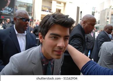 "HOLLYWOOD, CA-APRIL 17: Singer Joe Jonas arrives at the premiere of Walt Disney's movie ""Oceans"" at the El Capitan Theatre, April 17, 2010 in Hollywood, California."