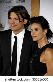"""HOLLYWOOD, CALIFORNIA - January 11, 2010. Ashton Kutcher and Demi Moore at the Los Angeles premiere of """"No Strings Attached"""" held at the Regency Village Theatre, Los Angeles."""