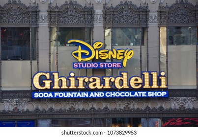 Hollywood, California - January 12, 2018: Signages of Disney Studio Store and Ghirardelli seen along Hollywood Boulevard.