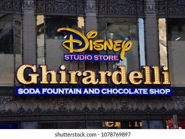 Hollywood, California - January 12, 2018: Disney Studio Store and Ghirardelli soda fountain and chocolate shop signs in front of the building.