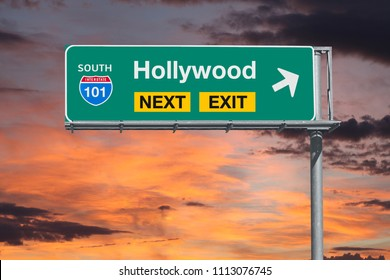 Hollywood California route 101 freeway next exit sign with sunset sky.