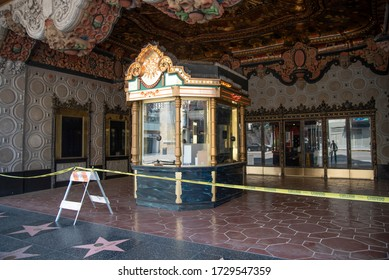 Hollywood, CA/USA - May 9, 2020: Ticket booth of the famous El Capitan Theatre taped off during coronavirus quarantine