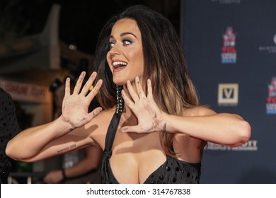 """HOLLYWOOD, CA/USA -  SEPTEMBER  08  2015: Katy Perry has her handprints placed in cement during the World Premiere of """"Jeremy Scott: The People's Designer"""" at the TCL Chinese Theatre"""