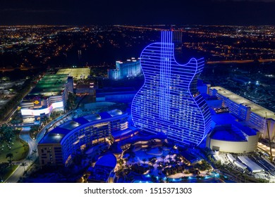 HOLLYWOOD, FL, USA - SEPTEMBER 25, 2019: Aerial drone photo of the Seminole Hard Rock Casino Hotel Resort located at 1 Seminole Way lit in bright neon blue lights