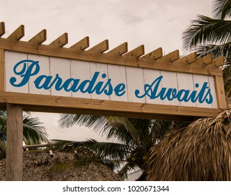 Hollywood, Florida - January 10, 2018: This Paradise Awaits sign was seen by the pool area at the new Margaritaville Resort in Hollywood, Florida on this date.