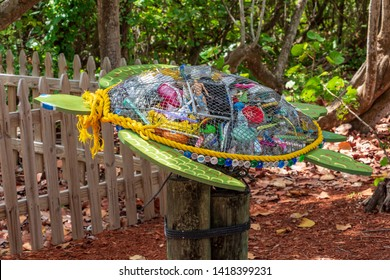 HOLLYWOOD, FLORIDA, USA - JUNE 7, 2019: Trash from Florida beaches and the Atlantic ocean, upcycled into a public display at Hollywood North Beach Park, warning of the dangers posed to sea life