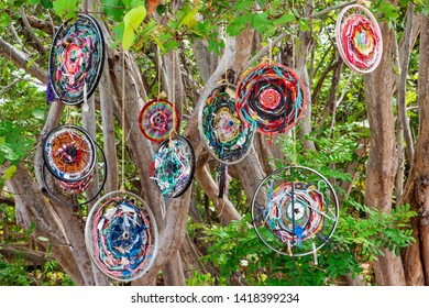 HOLLYWOOD, FLORIDA, USA - JUNE 7, 2019: Bicycle rims and other trash from Florida beaches and the Atlantic ocean, upcycled into a colorful public display at Hollywood North Beach Park