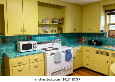 HOLLYWOOD, FLORIDA, USA - JUNE 7, 2019: Retro 1940s style kitchen with yellow cabinets and blue tile, at the historic Carpenter House