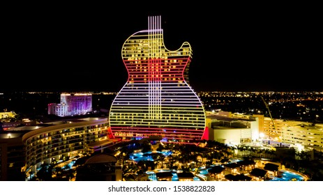 Hollywood, Florida/USA - October 22, 2019: Aerial view on New Hard Rock Casino Hotel, two days before Grand Open Ceremony. Oasis Tower Aerial View. The Guitar Hotel at Night.