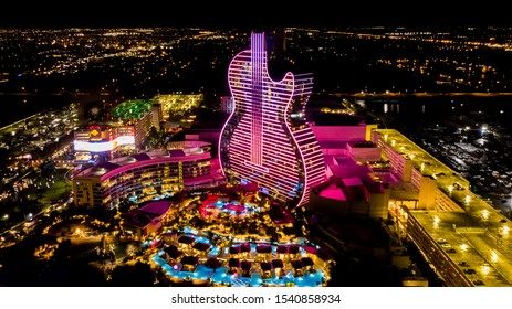 Hollywood, Florida/USA - October 24, 2019: Aerial view on New Hard Rock Casino Hotel, Grand Open Ceremony Guitar Hotel and Oasis Tower at Night. Guitar Hotel in Purple Light.