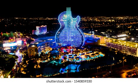Hollywood, Florida/USA - October 24, 2019: Aerial view on New Hard Rock Casino Hotel, Grand Open Ceremony Guitar Hotel and Oasis Tower at Night. Guitar Hotel in Blue Neon Light.