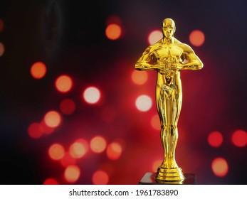 Hollywood Golden Oscar Academy award statue. Success and victory concept.