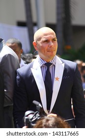HOLLYWOOD - JUNE 20, 2013: Pitbull attends Walk of Fame ceremony where Jennifer Lopez received the 2500th star in front of the W Hotel June 20, 2013 Hollywood, CA.