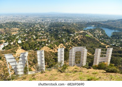 HOLLYWOOD - JUNE 20: The Hollywood sign towers over the Hollywood Hills and Lake Hollywood on a sunny day on June 20, 2017 in Los Angeles, California, USA.