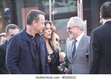 HOLLYWOOD  - JUNE 27: Director/actor Tom Hanks and wife Rita Wilson walk the red carpet at the premiere of the movie Larry Crowne at Grauman's Chinese Theatre on June 27, 2011 Hollywood, CA.
