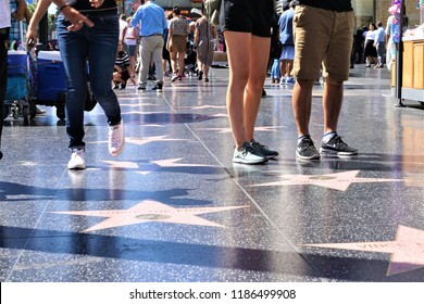Hollywood, LA, USA - September 18, 2018; Tourists walking on the Hollywood Walk of Fame is located on Hollywood Boulevard, Los Angeles.