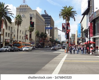 Hollywood, Los Angeles, California / United States - December 23 2012: Hollywood Boulevard and Highland Avenue (road sign) intersection in Hollywood, Los Angeles, California, United States.