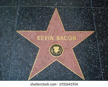 Hollywood, Los Angeles - June 2014. Kevin Bacon star on Hollywood Walk of Fame, in Hollywood Boulevard.