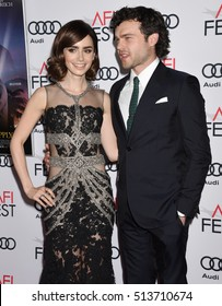 """HOLLYWOOD - NOV 10:  Lily Collins and Alden Ehrenreich arrives to the AFI FEST 2016 """"Rules Don't Apply"""" World Premiere Opening Night Gala  on November 10, 2016 in Los Angeles, CA"""