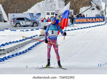 Holmenkollen, Norway - MARCH 18, 2017: Anton Shipulin of Russia finishes with russian flag in the pursuit at the BMW IBU World Cup Biathlon 9